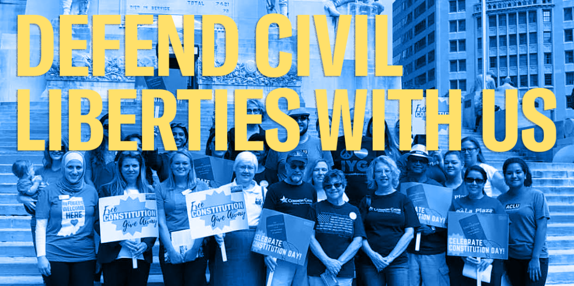 """a group of ACLU of Indiana volunteers with constitution day signs and header that read """"defend civil liberties with us"""""""